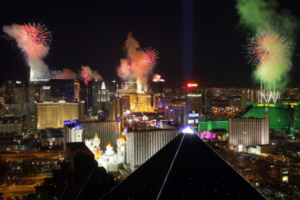 Fireworks explode over Las Vegas Strip casinos just after midnight January 1, 2011. Photo taken from the Mix nightclub in THEhotel at Mandalay Bay. STEVE MARCUS
